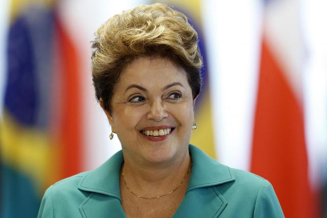 Brazil's President Dilma Rousseff smiles during a signing ceremony with Chile's President Michelle Bachelet at the Planalto Palace in Brasilia, June 12, 2014. REUTERS/Ueslei Marcelino