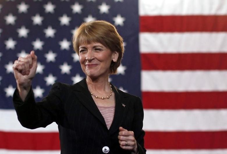 Martha Coakley gestures to the crowd during a campaign rally at Northeastern University in Boston January 17, 2010.   REUTERS/Jim Young
