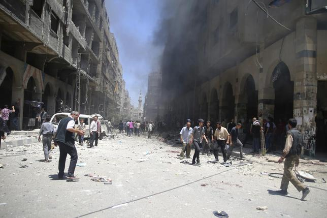 Smoke rises due to what activists claimed was shelling by forces loyal to Syrian President Bashar al-Assad in a market in central Duma in the eastern al-Ghouta, near Damascus June 15, 2014. REUTERS/Mohammed Abdullah