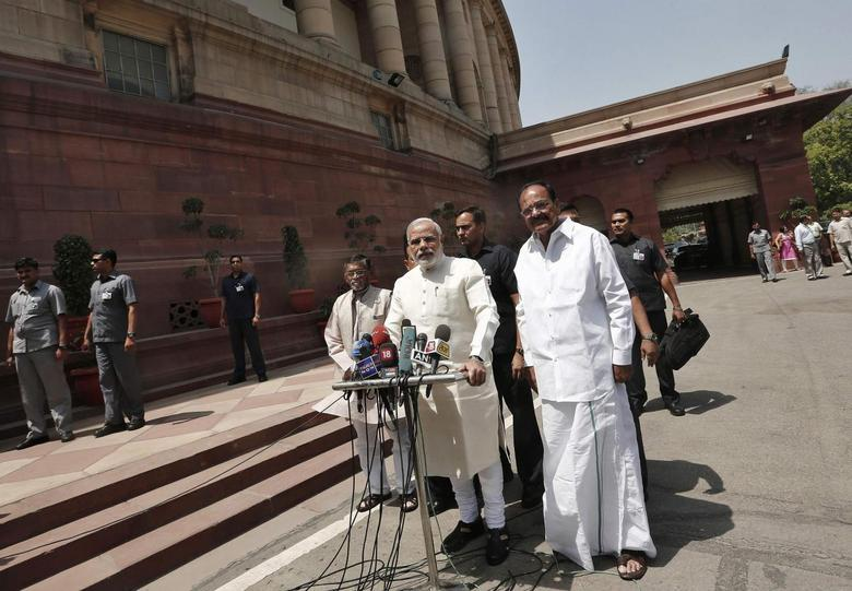 India's Prime Minister Narendra Modi (C) speaks with the media as he arrives to attend his first Parliament session in New Delhi June 4, 2014. REUTERS/Adnan Abidi