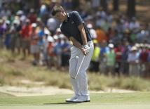 Amateur Matthew Fitzpatrick chips onto the fifth green during the first round of the U.S. Open Championship golf tournament in Pinehurst, North Carolina, June 12, 2014. REUTERS/Robert Galbraith