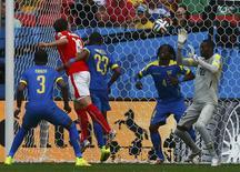 Switzerland's Admir Mehmedi heads the ball to score. REUTERS/Eddie Keogh