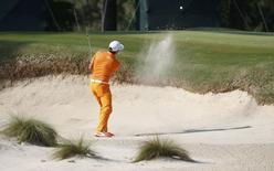 Rickie Fowler hits from a sand trap on the ninth hole during the final round of the U.S. Open Championship golf tournament in Pinehurst, North Carolina, June 15, 2014. REUTERS/Mike Segar