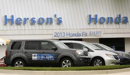 A Honda new car lot shows vehicles available for 0.9 per cent financing in Rockville, Maryland June 12, 2014. REUTERS/Gary Cameron