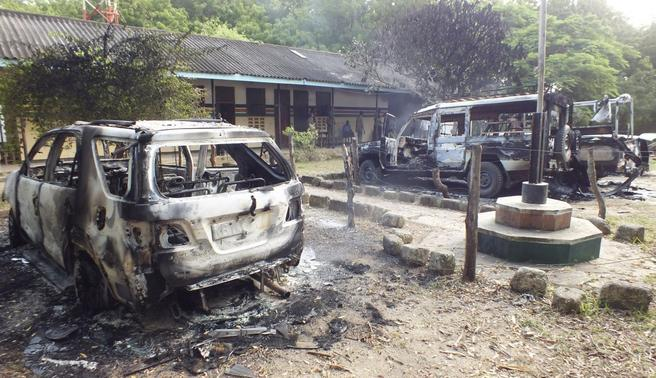 Wreckages of burnt cars are seen outside the Mpeketoni police station after unidentified gunmen attacked the coastal Kenyan town of Mpeketoni, June 16, 2014. REUTERS-Asuu Asuu
