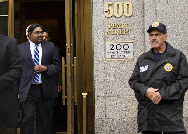 Galleon hedge fund founder Raj Rajaratnam (L) departs Manhattan Federal Court after his sentencing in New York October 13, 2011. REUTERS/Lucas Jackson/Files
