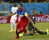 Clint Dempsey of the U.S. celebrates after scoring their first goal during their 2014 World Cup Group G soccer match against Ghana at the Dunas arena in Natal June 16, 2014. REUTERS/Toru Hanai