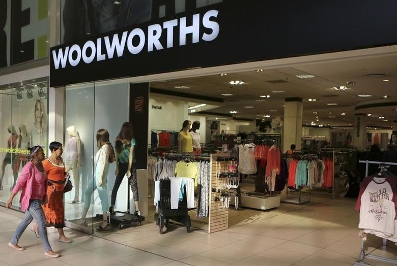 Shoppers walk into a Woolworths store at a shopping center in Lenasia, south of Johannesburg August 28, 2013. REUTERS/Siphiwe Sibeko