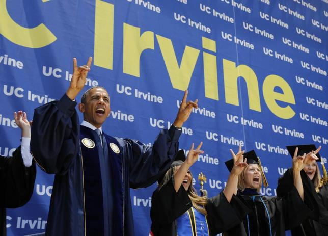 President Barack Obama yells ''Zot! Zot! Zot!'' to honor the school mascot, the anteater, as he attends the commencement ceremony for the University of California, Irvine at Angels Stadium in Anaheim, California June 14, 2014. REUTERS/Larry Downing
