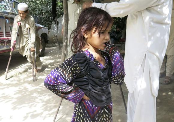 A girl fleeing the military offensive against the Pakistani militants in North Waziristan, reacts while taking refuge with her family in a school building in Bannu, located in Pakistan's Khyber-Pakhtunkhwa province June 17, 2014. REUTERS/Zahid Mohammad