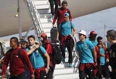 Portugal players arrive at the Viracopos airport ahead of the 2014 World Cup, in Campinas near Sao Paulo, June 11, 2014. REUTERS/Nacho Doce