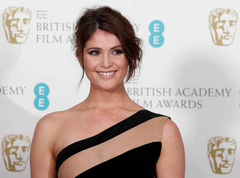 Gemma Arterton poses for photographers at the British Academy of Film and Arts (BAFTA) awards ceremony at the Royal Opera House in London February 10, 2013. REUTERS/Suzanne Plunkett/Files
