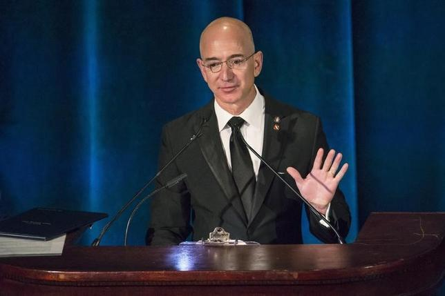 Amazon CEO and Chairman Jeff Bezos receives the Citation of Merit on behalf of the Apollo F-1 Search and Recovery Team during the 110th Explorers Club Annual Dinner, at the Waldorf Astoria in New York March 15, 2014. REUTERS/Andrew Kelly