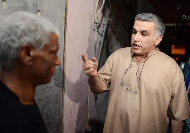 Activist Nabeel Rajab (R) speaks to his neighbour after his release from jail, in the village of Bani Jamra, west of Manama May 24, 2014. REUTERS/Stringer
