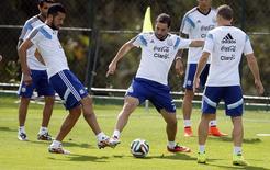 Jogadores da Argentina durante treino em Vespasiano, perto de Belo Horizonte. 18/6/2014 REUTERS/Sergio Perez