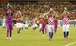 Jogadores da Croácia após a partida contra Camarões na Arena Amazônia, em Manaus. 18/6/2014 REUTERS/Siphiwe Sibeko