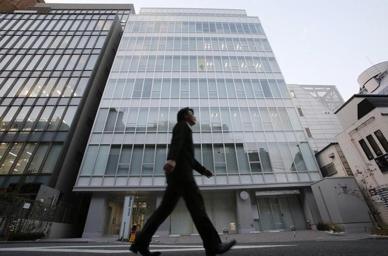 A man walks past a building where Mt. Gox, a digital marketplace operator, is housed in Tokyo February 25, 2014. REUTERS/Toru Hanai