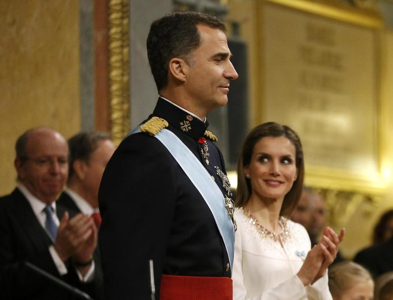Spain's new King Felipe VI and his wife Queen Letizia attend the swearing-in ceremony at the Congress of Deputies in Madrid, June 19, 2014. REUTERS/Juan Medina