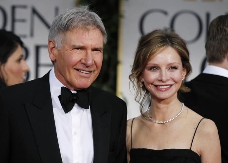 Actors Harrison Ford and Calista Flockhart arrive at the 69th annual Golden Globe Awards in Beverly Hills, California January 15, 2012. REUTERS/Danny Moloshok
