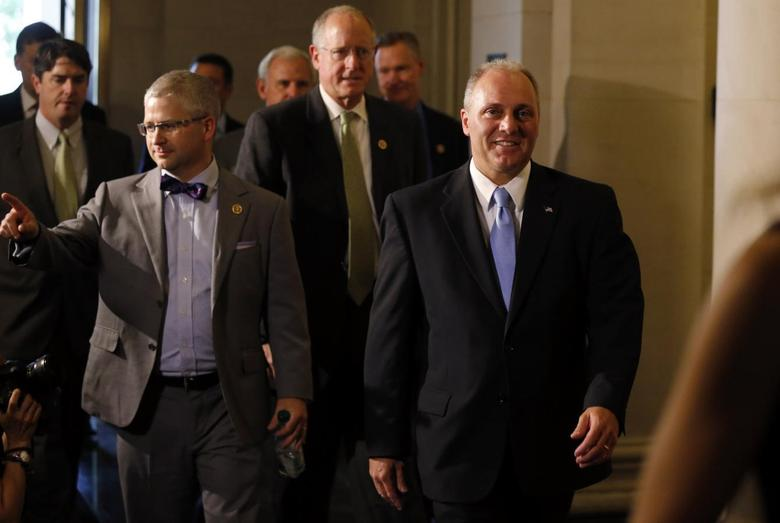 House Majority Whip candidate Steve Scalise (R) arrives with Rep. Patrick McHenry (L) for House Republican leadership elections in the Longworth House Office Building on Capitol Hill in Washington, June 19, 2014.  REUTERS/Jim Bourg