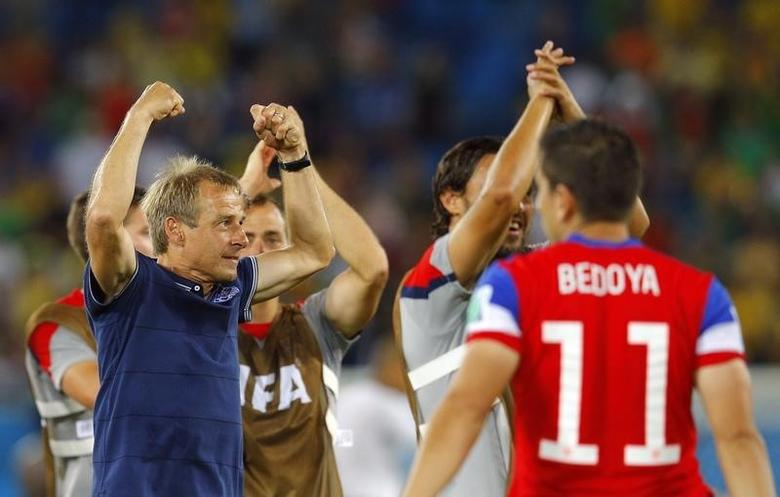 U.S. coach Juergen Klinsmann (L) celebrates their win against Ghana after their 2014 World Cup Group G soccer match at the Dunas arena in Natal June 16, 2014. REUTERS/Brian Snyder