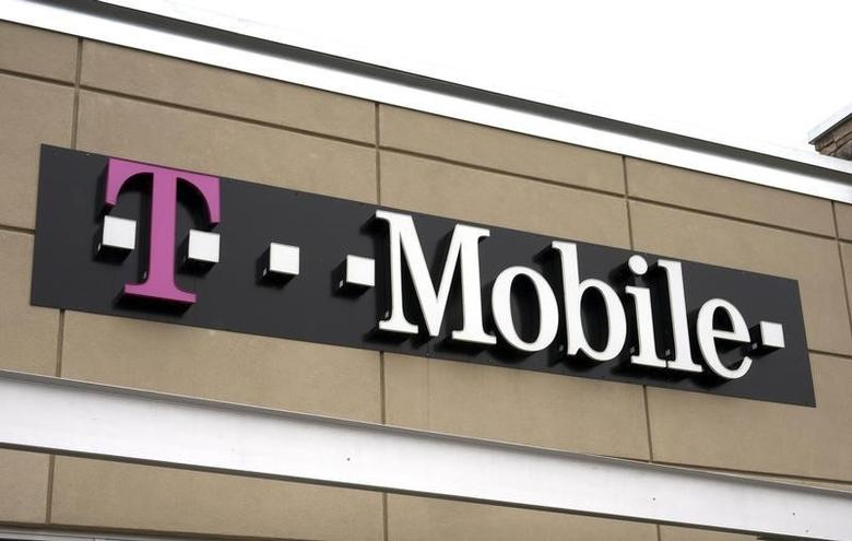 A T-Mobile store sign is seen in Broomfield, Colorado February 25, 2014. REUTERS/Rick Wilking