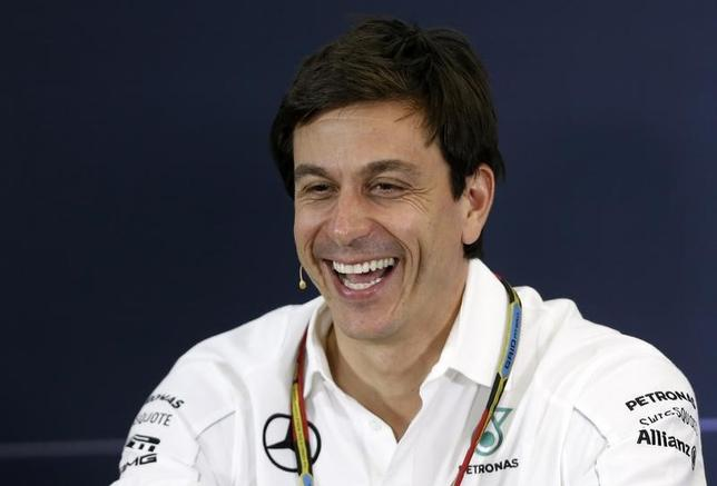 Mercedes Formula One Executive Director (Business) Toto Wolff smiles during a news conference after the second practice session of the Australian F1 Grand Prix at the Albert Park circuit in Melbourne March 14, 2014. REUTERS/Brandon Malone