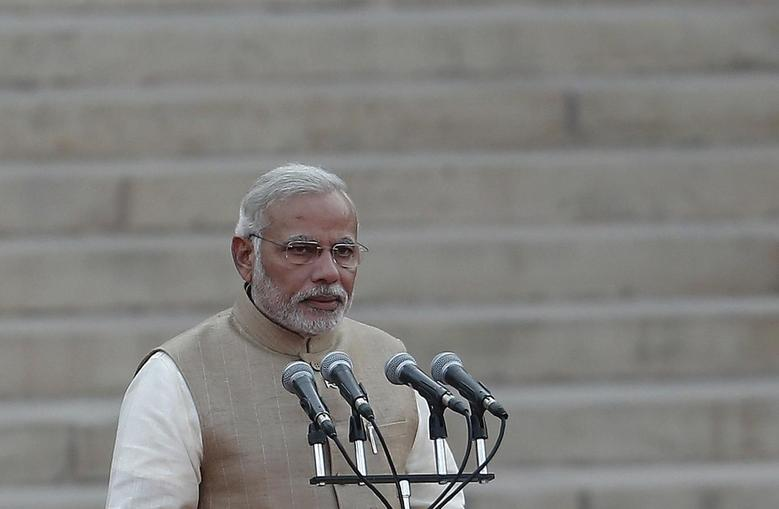 Prime Minister Narendra Modi takes his oath at the presidential palace in New Delhi May 26, 2014.  REUTERS/Adnan Abidi/Files