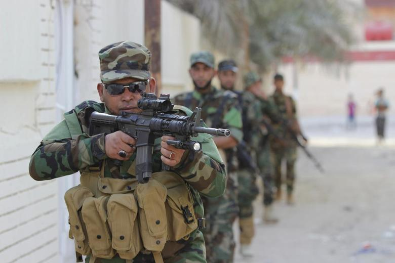 Iraqi forces ready push after Obama offers advisers