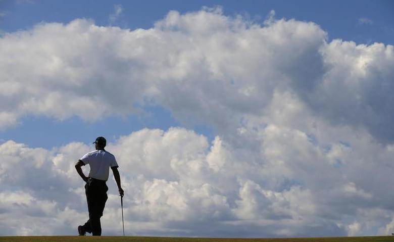 Tiger Woods of the U.S. waits to putt on the fourth green during the first round of the British Open golf championship at Muirfield in Scotland July 18, 2013.  REUTERS/Brian Snyder
