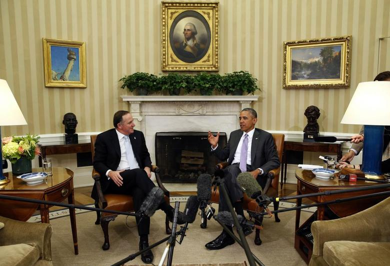 U.S. President Barack Obama meets New Zealand Prime Minister John Key in the Oval Office of the White House in Washington June 20, 2014.  REUTERS/Kevin Lamarque