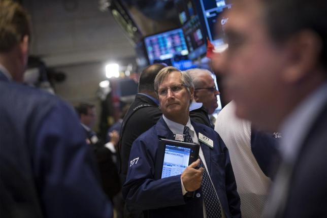 Traders work on the floor of the New York Stock Exchange June 19, 2014. REUTERS/Brendan McDermid