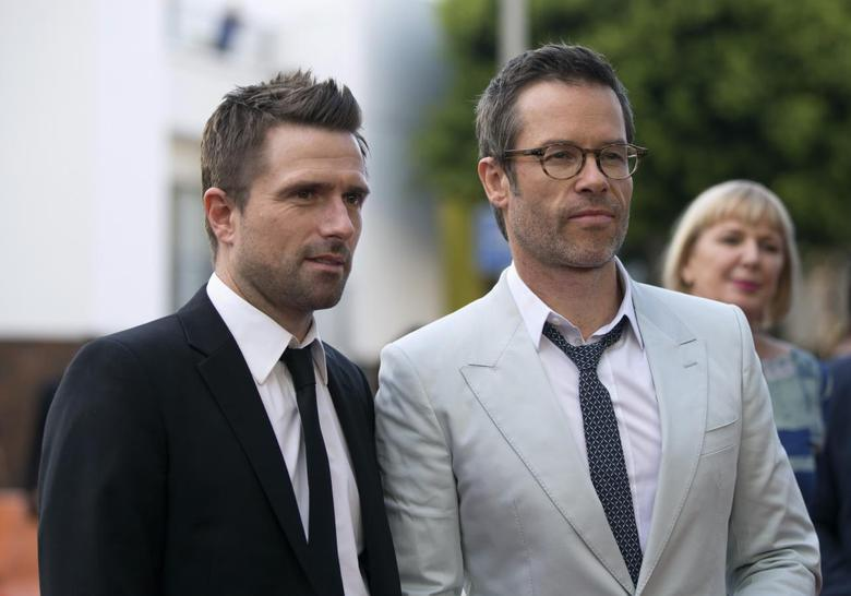 Director of the movie David Michod (L) poses with cast member Guy Pearce at the premiere of ''The Rover'' in Los Angeles, California June 12, 2014 file photo. REUTERS/Mario Anzuoni