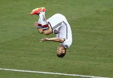 Atacante alemão Miroslav Klose comemora gol marcado contra Gana em Fortaleza. 21/06/2014 REUTERS/Mike Blake