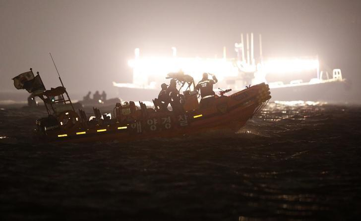 South Korean rescue workers operate where the capsized passenger ship Sewol sank, as fishing boats emit light during the night rescue operation in Jindo April 22, 2014. REUTERS/Issei Kato