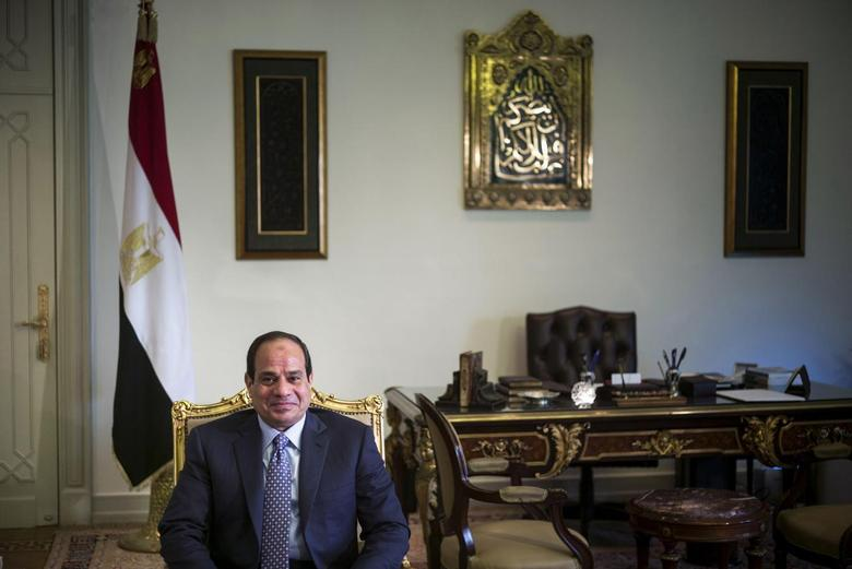 Egypt's President Abdel Fattah al-Sisi sits in his office before a meeting with U.S. Secretary of State John Kerry at the Presidential Palace in Cairo June 22, 2014.  REUTERS/Brendan Smialowski/Pool