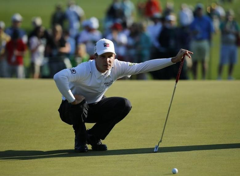 U.S. golfer Kevin Streelman looks at his putt on the seventh green during the second round of the Masters golf tournament at the Augusta National Golf Club in Augusta, Georgia April 11, 2014. REUTERS/Mike Blake