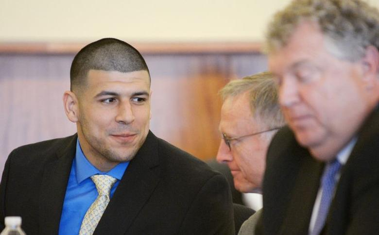 Former NFL New England Patriots football player Aaron Hernandez talks with his defense attorney, Charles Rankin (C) during a hearing at the Bristol County Superior Court House in Fall River, Massachusetts, June 16, 2014.  REUTERS/Faith Ninivaggi/POOL