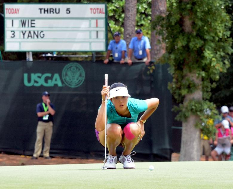 Jun 22, 2014; Pinehurst, NC, USA; Michelle Wie reads a birdie putt on the sixth hole during the final round of the U.S. Women's Open at the Pinehurst Resort and Country Club-#2 Course. Mandatory Credit: Rob Kinnan-USA TODAY Sports