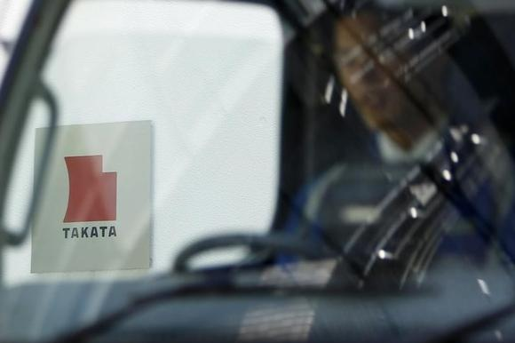 A logo of Takata Corp is seen through a car window outside the company's headquarter building in Tokyo April 12, 2013. REUTERS/Yuya Shino/Files