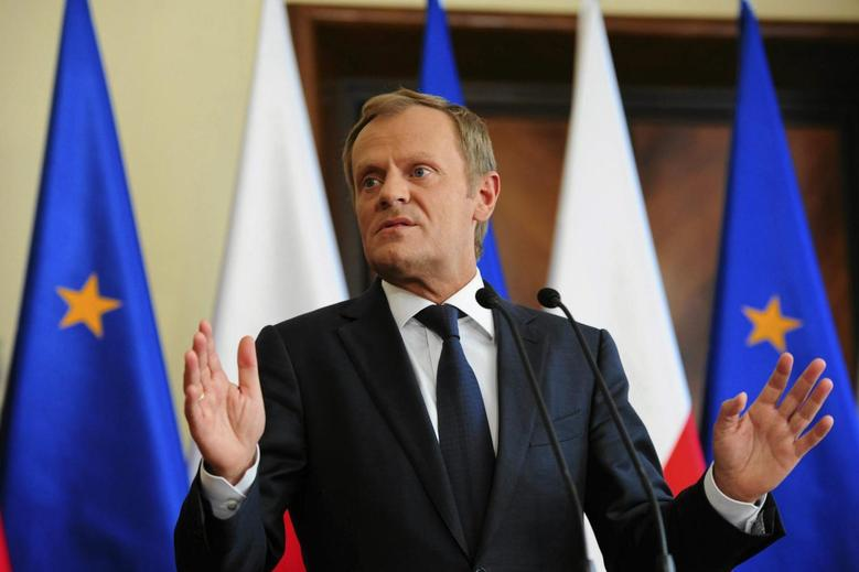 Poland's Prime Minister Donald Tusk gestures as he speaks during a news conference at the Prime Minister Chancellery in Warsaw June 16, 2014. REUTERS/Adam Stepien/Agencja Gazeta