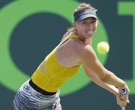 Mar 27, 2014; Miami, FL, USA; Maria Sharapova hits a backhand against Serena Williams (not pictured) on day eleven of the Sony Open at Crandon Tennis Center. Mandatory Credit: Geoff Burke-USA TODAY Sports