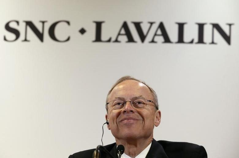 Robert G. Card, president and chief executive officer of SNC-Lavalin, smiles while addressing the media following their annual general meeting in Montreal, May 8, 2014. REUTERS/Christinne Muschi