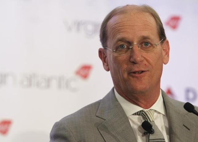 Delta Chief Executive Richard Anderson speaks during a news conference to announce the sale of Virgin Atlantic airline to Delta Air Lines, in New York December 11, 2012. REUTERS/Brendan McDermid