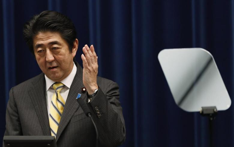 Japan's Prime Minister Shinzo Abe speaks next to a teleprompter during a news conference at his official residence in Tokyo June 24, 2014.  REUTERS/Yuya Shino