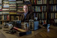 Conceptual artist Jonathon Keats displays equipment used to develop his Century Camera project, in San Francisco, California June 23, 2014.  REUTERS/Noah Berger