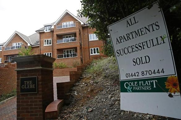A sign is seen outside some newly built apartments in Berkhampstead, southern England August 13, 2013. REUTERS-Eddie Keogh