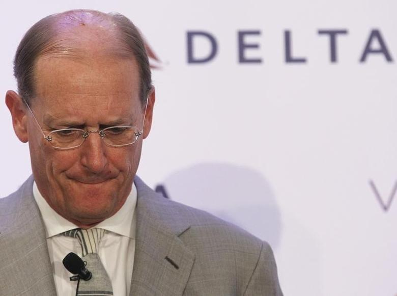 Delta Chief Executive Richard Anderson listens during a news conference to announce the sale of Virgin Atlantic airline to Delta Air Lines, in New York December 11, 2012. REUTERS/Brendan McDermid