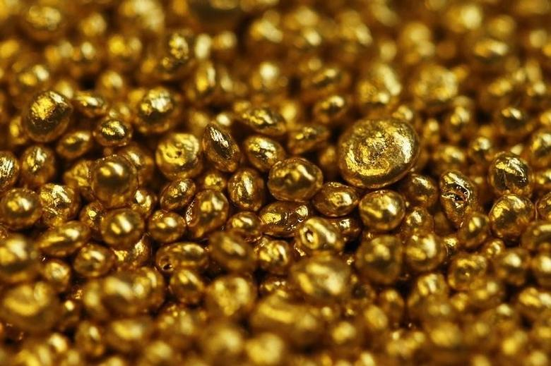 Gold granulate is seen at a plant of gold refiner and bar manufacturer Valcambi SA in the southern Swiss town of Balerna December 20, 2012. REUTERS/Michael Buholzer