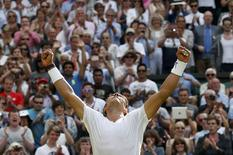 Rafael Nadal of Spain reacts after defeating Martin Klizan of Slovakia in their men's singles tennis match at the Wimbledon Tennis Championships, in London June 24, 2014. REUTERS/Suzanne Plunkett